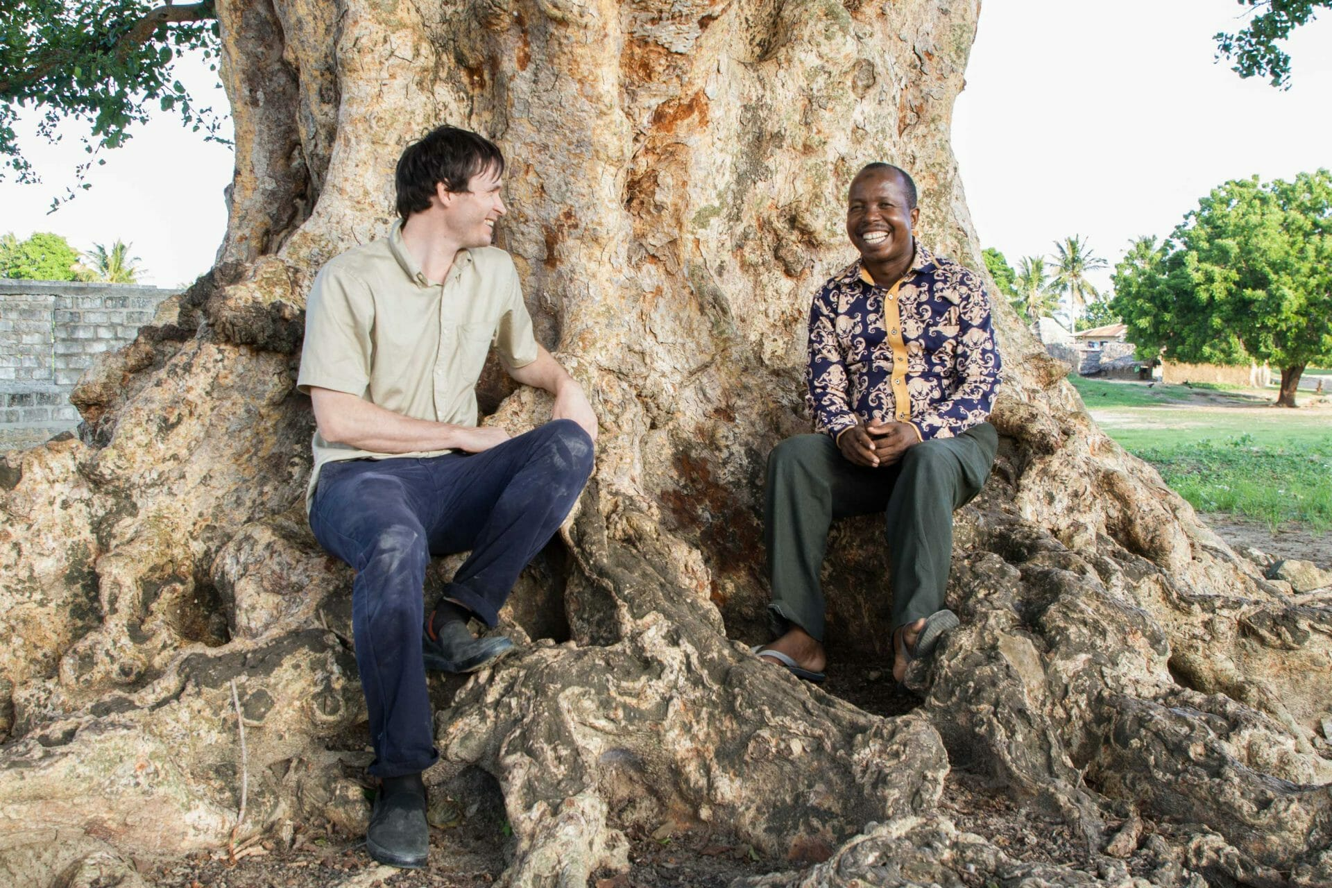 Daimen Hardie sits at the bottom of a tree with CFP's Executive Director.